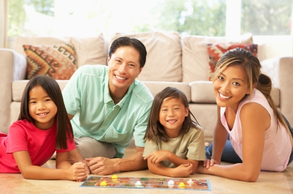 Family Playing Board Game At Home